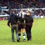 Jonah Lomu leaves the pitch escorted by Cardiff Blues Medical staff